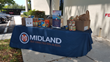 Midland IRA Holds Canned Food Drive for the Harry Chapin Food Bank