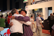 PMQ Pizza Magazine Publisher gives Jamie Culliton a congratulatory hug after winning the individual acrobatics competition at The World Pizza Championships