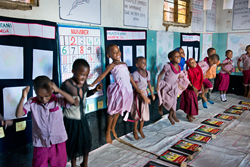 Children engage in play-based learning at a BRAC school in Tanzania.
