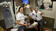 JBDC Team welcomes new patient receiving her free dental treatment