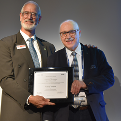 SPIE President Robert Lieberman, at left, presents Valery Tuchin with the 2016 Joseph W. Goodman Book Writing Award during SPIE Photonics Europe.