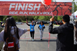 Never giving up, participants sprint across the finish line.