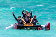 Nels Gerhard Glesne kitesurfs a modified catamaran with his son and instructors.