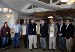 Billman Trucking, Dexter Axle, Key Electronics, and Peer Bearing (from left to right) were awarded the Wood-Mizer CREST Award for 2015.
