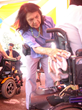 Civil Rights Activists Dolores Huerta washing wheelchairs at a Familia Unida community wheelchair wash.