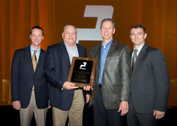 Pictured  from the left, Ken Roemer (President, Paccar Leasing), Ron Neumuth (Lease & Rental General Manager, JX Enterprises), Randy Buening (Vice President of Operations, JX Enterprises), and Jake Civitts (Director of Franchise Operations, Paccar Leasing