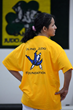 Christella Garcia proudly wearing the T-Shirt of the Blind Judo Foundation