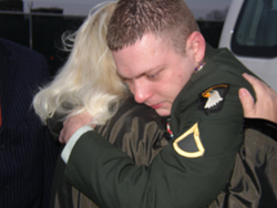 An emotional 22-year-old PFC Corey Clagett hugs his mom, Melanie Dianiska, outside the Fort Campbell, Kentucky military courthouse just prior to his hearing and sentencing to life in prison, 18 years, with the possibility of parole after 6. He was paroled
