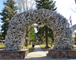 Four giant elk antler arches frame the famous Jackson Town Square, location of many Jackson Hole ElkFest and Old West Days events taking place this May.