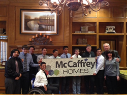 Students in the Madera High School Social Skills Autism Class present a mosaic to Robert and Karen McCaffrey of McCaffrey Homes