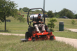 Cesar Moran of Agroland of Spicewood, TX demonstrates how easy it is to mow with cleaner-burning propane at the Propane in the Park event at Southeast Metropolitan Park in Del Valle, TX