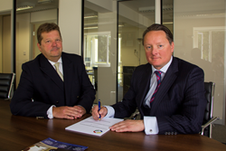 Gary Dewhurst of Gap Personnel and Patrick Gill of PRS Telecom agreeing the deal.