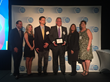 Paul H. Griswold, President and CEO accepting the #18 ranking for Best Place to work in NYS Award on behalf of Finger Lakes Technologies Group, Inc.
