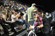 A graduate pauses for a photo with his daughter during the 2016 commencement ceremony for Salt Lake Community College.