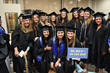 Graduates pause for a photo before the commencement ceremony for Salt Lake Community College.