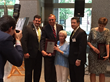 Mark Hendrix, Jean Price, and Kris Weiss receive Ray Price's induction plaque at the N.C. Sports Hall of Fame ceremony.