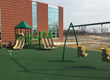 The ADA accessible playground includes climbers, slides and adaptive swing seats.