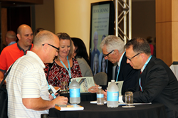 Robert J. Marzano and Michael D. Toth sign books at the Building Expertise education conference.