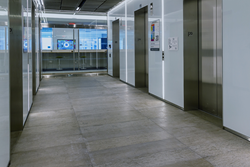 Concreate concrete plank flooring in the color Dark Gray, in an elevator lobby.