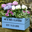 Crates, recycled or purchased, can be painted and personalized to create a colorful, unique planter for flowers and edibles. Photo credit:  PersonalizedCrates.com