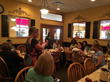 NAPW Member, Susan Campbell, sharing details on her Armaband with her fellow Carrollton, TX Chapter members