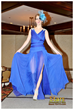 A dramatic deep blue gown captures the eye with layers of movement on the runway