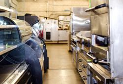 Surplus Asset Management prepares commercial equipment for auction.