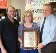 Youngstown, Ohio Minuteman Press franchise owners Dean Seifert (left) and Dawn Seifert (center), along with Gary Nowak (right), Minuteman Press International Regional Vice President for the Ohio region.