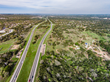 Looking north on South Mopac; Wildflower Center in lower right TxDOT plans would add six lanes within the green median, 3 lanes in each direction.