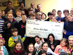 Barrington Elementary Students with a Check for Money They Raised to Help Honduran Students