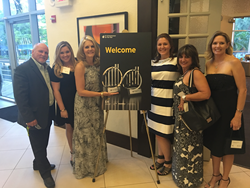 Michelle Fee, CEO of Cruise Planners, an American Express Travel Representative, (Center) is recognized as a finalist for the EY Entrepreneur Of The Year® 2016 Award in Florida on May 25, 2016.