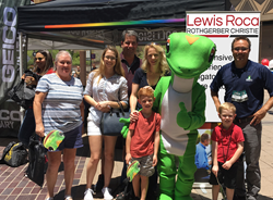 Lewis Roca Rothgerber Christie representatives at the GEICO car giveaway before Military Appreciation Day at the Arizona Diamondbacks game.