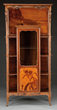 Lot #2208, a c. 1900 Majorelle marquetry display cabinet estimated at $10,000-15,000.