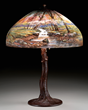 Lot #1412, a Handel mountain stream table lamp estimated at $10,000-15,000.