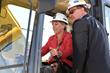 Salt Lake Community College President Deneece G. Huftalin powers a backhoe to help break ground for SLCC's new Westpointe Career and Technical Education Center.