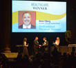 Adam Elberg accepting Deals of Distinction Award for Healthcare Industry