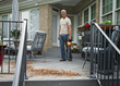 WORX_Turbine450_7.5AMP_Blower_WG517_MAN BLOWING LEAVES OFF PORCH.jpg