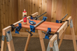 Rockler's Pipe Clamp Mounting Brackets attach to 2x stock, so they can hold material on top of the sawhorse or serve as an on-site vise for such operations as planing the edge of a door.