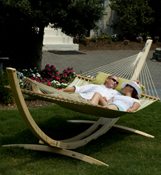 Couple relaxing outdoors in a hammock