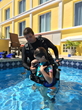 Dive instructor Matt Weicker teaches teaches ten-year old Scout Dingman how to scuba dive while at Caravelle Hotel in St. Croix.