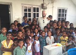 Andrew Smith with children at the Azlynn Noelle Children's Home