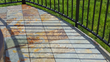 """Martin Builders used 3/8"""" thick 12"""" x 12"""" porcelain pavers secured with one-inch high Stone-Edg paver restraints on a recently completed residential expanded deck project."""