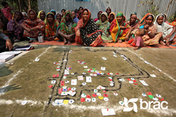 "A group of community leaders map out the poorest households in their region as part of BRAC's ""Targeting the Ultra-Poor"" program. Households chosen will join a two-year initiative. Credit: BRAC"