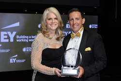 Michelle Fee, CEO of Cruise Planners, is presented with the EY Entrepreneur Of The Year® Award in Hospitality and Leisure