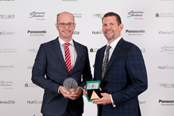 Qmatic senior executives Sven-Olof Husmark and Jeff Green accept the People's Choice Stevie Award for Favorite New Product at the 2016 American Business Awards.