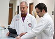 Dr. Ron Cook, chairman of the TTUHSC Department of Family Medicine and Dr. Chaz Willnauer working on clinical cases.