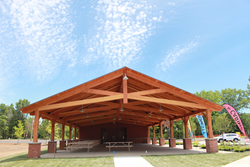 The community pavilion that New Energy Works Timberframers created for the Saratoga Regional YMCA has a scissors truss design that forms a vaulted ceiling and creates optimal space for activities.