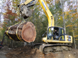 A 60,000 pound excavator was needed to unload the log truck. A 60,000 pound excavator was needed to unload the log truck.