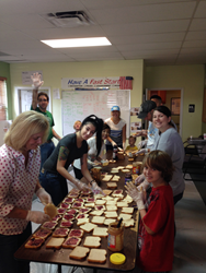 Volunteers make sandwiches for the homeless at this PB&J for Tampa Bay Feeding Frenzy in May of 2016.