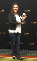Amber Johnson holding the Incentive Solutions Best & Brightest award